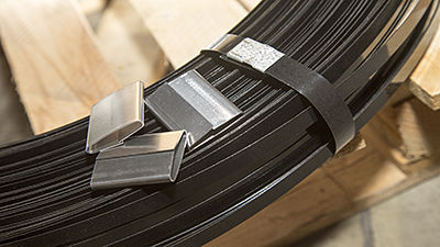 Steel seal for strapping